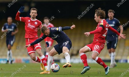 Jason Demetriou of Southend United (24) and Sam Matthews of Crawley Town (20)