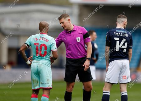 Referee Robert Jones talking to Andre Ayew of Swansea City and Scott Malone of Millwall after an altercation; The Den, Bermondsey, London, England; English Championship Football, Millwall Football Club versus Swansea City.