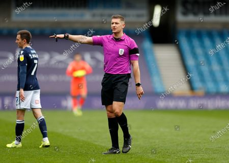 Referee Robert Jones wearing a black arm band in tribute to to Prince Philip, Duke of Edinburgh, who died in Windsor Castle on 9th April 2021; The Den, Bermondsey, London, England; English Championship Football, Millwall Football Club versus Swansea City.