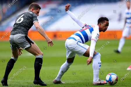 Chris Willock of Queens Park Rangers under pressure from Sam Hutchinson of Sheffield Wednesday; The Kiyan Prince Foundation Stadium, London, England; English Football League Championship Football, Queen Park Rangers versus Sheffield Wednesday.