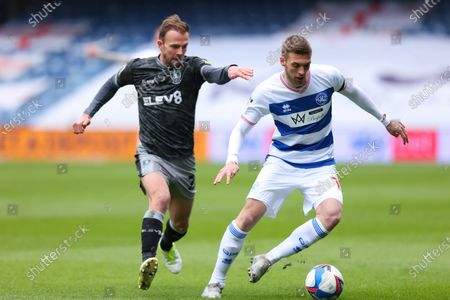 Sam Field of Queens Park Rangers takes on Jordan Rhodes of Sheffield Wednesday; The Kiyan Prince Foundation Stadium, London, England; English Football League Championship Football, Queen Park Rangers versus Sheffield Wednesday.