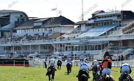 The field of the Randox Health Topham Steeple Chase race approach the Queen Mother Stand where the Union Jack flies at half-mast on Ladies Day at the racecourse in Aintree, Britain, 09 April 2021, following the death of Prince Philip, Duke of Edinburgh and husband of Queen Elizabeth II. The Buckingham Palace on 09 April 2021 announced that Prince Philip has died aged 99.
