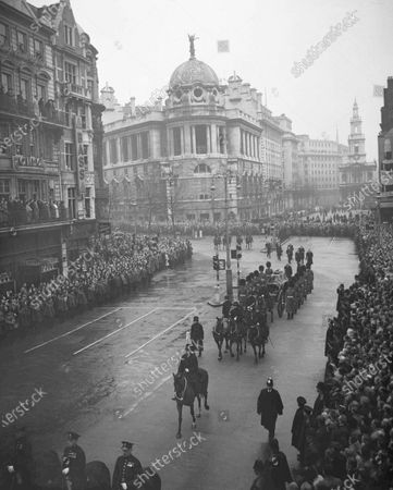 The cortege turns from Aldwych into the Strand, in London, en route to Westminster Hall. Walking behind the coffin are the Duke of Gloucester, left, and the Duke of Edinburgh. The coffin, borne on a gun carriage and drawn by six bay horses of the King's Troop, Royal Horse Artillery, is flanked by bearers of the King's Company, Grenadiers Guards. Prince Philip was born into the Greek royal family but spent almost all of his life as a pillar of the British one. His path was forged when he married the heir to the British throne, and a promising naval career was cut short when his wife suddenly became Queen Elizabeth II. Nevertheless, he set about forging a place for himself as royal consort. He was a patron of charities and a supporter of projects for young people. He was married for more than 73 years and was still carrying out royal engagements into his late 90s