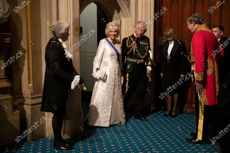 Britain's Prince Charles, third left, and his wife Camilla the Duchess of Cornwall, second left, arrive in the Norman Porch, flanked at left by Black Rod, Sarah Clarke the first ever female to serve in the role of Black Rod, at the Palace of Westminster and the Houses of Parliament for the State Opening of Parliament ceremony in London. Prince Philip was the longest serving royal consort in British history. In Britain, the husband or wife of the monarch is known as consort, a position that carries immense prestige but has no constitutional role. The wife of King George VI, who outlived him by 50 years, was loved as the Queen Mother. Prince Charles' wife, Camilla, has worked to emerge from the shadow of his immensely popular first wife, Diana
