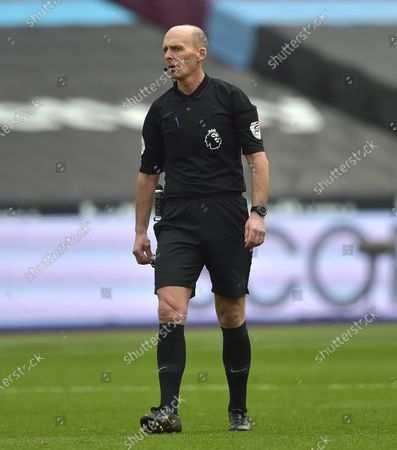 Referee Mike Dean in charge in the match between West Ham United and Leceister City