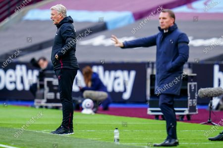 David Moyes West Ham United Manager shouts from the sideline alongside Brendan Rogers Leicester City Manager