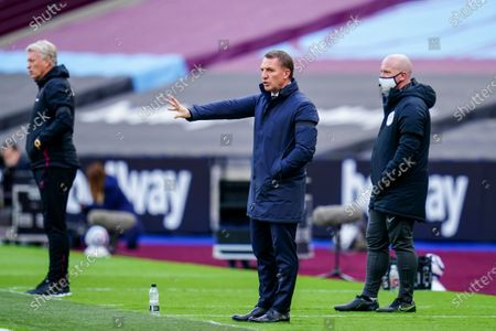 Stock Photo of Brendan Rogers Leicester City Manager signals from the sideline alongside David Moyes West Ham United Manager