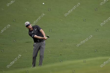 Zach Johnson chips to the second green during the second round of the Masters golf tournament, in Augusta, Ga
