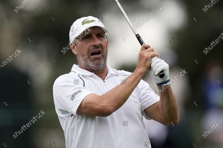 Stock Image of Jose Maria Olazabal, of Spain, reacts to his tee shot on the third hold during the second round of the Masters golf tournament, in Augusta, Ga