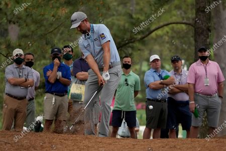 Webb Simpson hits out of the pine straw on the 17th hole during the second round of the Masters golf tournament, in Augusta, Ga