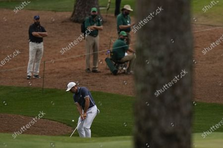 Marshalls look on as Sergio Garcia, of Spain, hits on the 15th hole during the second round of the Masters golf tournament, in Augusta, Ga
