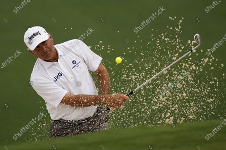 Stock Image of Fred Couples hits out of a bunker on the second hole during the second round of the Masters golf tournament, in Augusta, Ga
