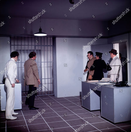 Marty Hopkirk, as played by Kenneth Cope, Jeff Randall, as played by Mike Pratt, Miklos Corri, as played by Kieron Moore, and Inspector Large, as played by Ivor Dean