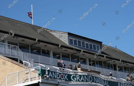The Union Jack flies at half-mast on Ladies Day over the Queen Mother Stand at the racecourse in Aintree, Britain, 09 April 2021, following the death of Prince Philip, Duke of Edinburgh and husband of Queen Elizabeth II. The Buckingham Palace on 09 April 2021 announced that Prince Philip has died aged 99.