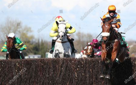 Jockey Sam Twiston-Davies on Master Tommytucker jump a fence the Marsh Steeple Chase race on Ladies Day at the Grand National Festival at the racecourse in Aintree, Britain, 09 April 2021.