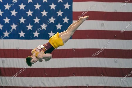 """Michael Moran, representing the University of Minnesota, competes during the Winter Cup gymnastics event, in Indianapolis. A junior from Morristown, New Jersey, Moran admits there were people within his inner circle who discouraged him from competing collegiately because they viewed his chosen sport as a """"dying entity."""" The University of Minnesota and the University of Iowa will stop offering it as a scholarship sport at the end of the month"""