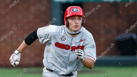 Stock Picture of Georgia's Cole Tate runs to first base during an NCAA baseball game against Vanderbilt, in Nashville