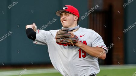 Georgia's Cole Tate throws to first base during an NCAA baseball game against Vanderbilt, in Nashville
