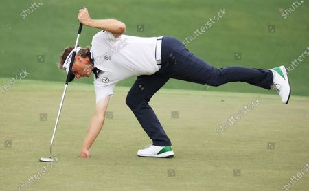 Stock Photo of Bernhard Langer of Germany retrieves his ball on the eighteenth hole during the second round of the 2021 Masters Tournament at the Augusta National Golf Club in Augusta, Georgia, USA, 09 April 2021. The 2021 Masters Tournament is held 08 April through 11 April 2021.