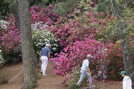 Sergio Garcia of Spain (L) and Webb Simpson of the US (R) look for Simpson's ball on the thirteenth hole during the second round of the 2021 Masters Tournament at the Augusta National Golf Club in Augusta, Georgia, USA, 09 April 2021. The 2021 Masters Tournament is held 08 April through 11 April 2021.