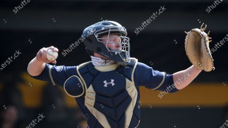 Stock Photo of Navy catcher Alex Smith (33) warms up between innings against Towson during an NCAA baseball game, in Towson, Md