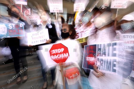 LOS ANGELES, CA - APRIL 8, 2021 - - Members of the Thai-American community along with political leaders and members of law enforcement participate in a rally against Asian hate crimes in Thai Town in Los Angeles on April 8, 2021. They also gathered to show solidarity for the AAPI community. Los Angeles City Councilman Mitch O'Farrell and Los Angeles City Attorney Mike Feuer spoke against anti-Asian sentiment at the rally. (Genaro Molina / Los Angeles Times)