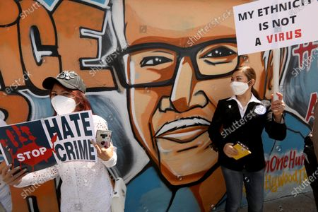 LOS ANGELES, CA - APRIL 8, 2021 - - Members of the Thai-American community protest against Asian hate crimes in front of a mural of Vicha Ratanapakdee in Thai Town in Los Angeles on April 8, 2021. Vicha Ratanapakdee was a Thai American man who died after being forcefully pushed to the ground in a daylight attack in San Francisco, California earlier this year. They also gathered at a rally, before the march, to show solidarity for the AAPI community. Los Angeles City Councilman Mitch O'Farrell, Los Angeles City Attorney Mike Feuer, other civic leaders and members of law enforcement spoke at the rally against anti-Asian sentiment at the rally. (Genaro Molina / Los Angeles Times)