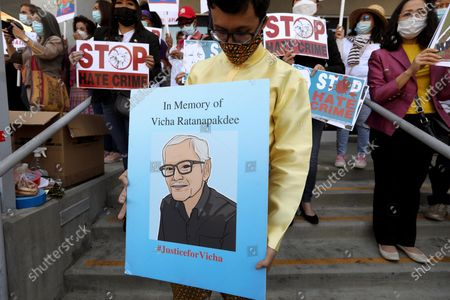 LOS ANGELES, CA - APRIL 8, 2021 - - A poster featuring Vicha Ratanapakdee was held in his memory as members of the Thai-American community participate in a rally against Asian hate crimes in Thai Town in Los Angeles on April 8, 2021. Vicha Ratanapakdee was a Thai American man who died after being forcefully pushed to the ground in a daylight attack in San Francisco, California earlier this year. The crowd also gathered to show solidarity for the AAPI community. Los Angeles City Councilman Mitch O'Farrell and Los Angeles City Attorney Mike Feuer spoke against anti-Asian sentiment at the rally. (Genaro Molina / Los Angeles Times)