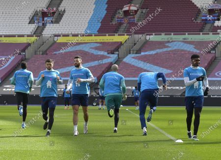 Stock Image of L-R Facing camera Aaron Cresswell,Ryan Fredericks and Ben Johnson of West Ham United during training