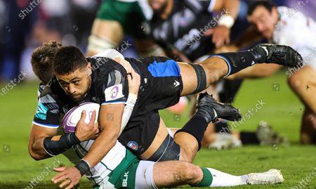 Bath Rugby vs London Irish. Bath's Taulupe Faletau with Tom Parton of London Irish