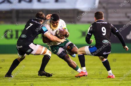 Bath Rugby vs London Irish. London Irish's Albert Tuisue with Josh Bayliss and Ben Spencer of Bath