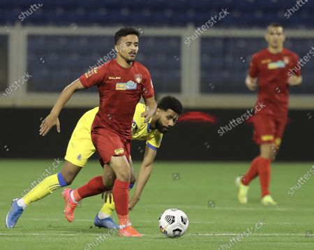 Damac's player Waleed Hizam (front) in action against Al-Nassr's Sami Al-Najei (back) during the Saudi Professional League soccer match between Damac and Al-Nassr at Prince Sultan bin Abdul Aziz Stadium, in Abha, Saudi Arabia, 09 April 2021.