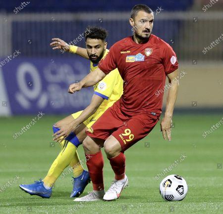 Damac's player Constantin Budescu (R) in action against Al-Nassr's Abdulrahman Al-Obaid (L) during the Saudi Professional League soccer match between Damac and Al-Nassr at Prince Sultan bin Abdul Aziz Stadium, in Abha, Saudi Arabia, 09 April 2021.