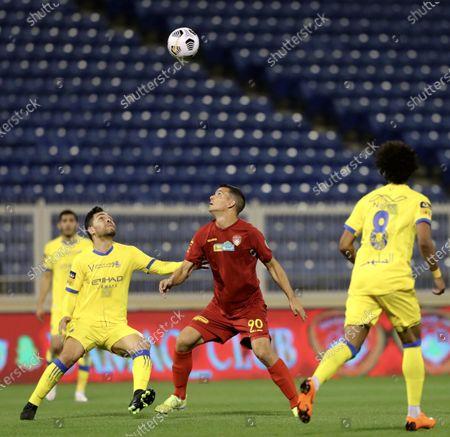 Damac's player Emilio Zelaya (C) in action against Al-Nassr's Petros (L) during the Saudi Professional League soccer match between Damac and Al-Nassr at Prince Sultan bin Abdul Aziz Stadium, in Abha, Saudi Arabia, 09 April 2021.