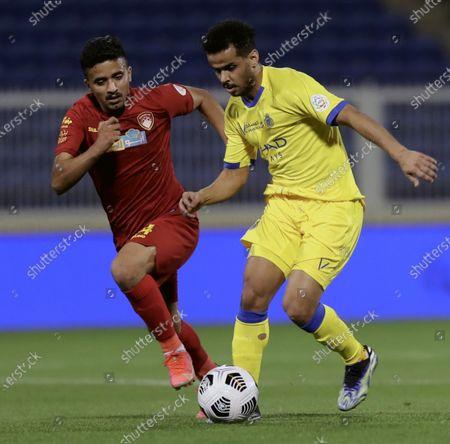 Damac's player Waleed Hizam (L) in action against Al-Nassr's Abdulfattah Asiri (R) during the Saudi Professional League soccer match between Damac and Al-Nassr at Prince Sultan bin Abdul Aziz Stadium, in Abha, Saudi Arabia, 09 April 2021.