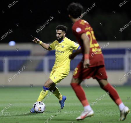 Damac's player Arif Al-Haydar (front) in action against Al-Nassr's Abdulrahman Al-Obaid (back) during the Saudi Professional League soccer match between Damac and Al-Nassr at Prince Sultan bin Abdul Aziz Stadium, in Abha, Saudi Arabia, 09 April 2021.