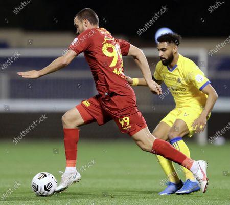 Damac's player Constantin Budescu (L) in action against Al-Nassr's Abdulrahman Al-Obaid (R) during the Saudi Professional League soccer match between Damac and Al-Nassr at Prince Sultan bin Abdul Aziz Stadium, in Abha, Saudi Arabia, 09 April 2021.