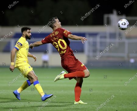 Damac's player Emilio Zelaya (R) in action against Al-Nassr's Abdulrahman Al-Obaid (L) during the Saudi Professional League soccer match between Damac and Al-Nassr at Prince Sultan bin Abdul Aziz Stadium, in Abha, Saudi Arabia, 09 April 2021.