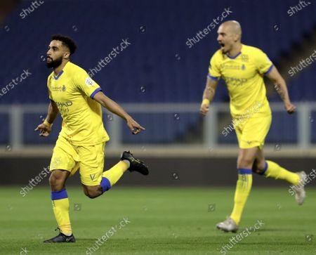 Al-Nassr's player Abdulrahman Al-Obaid (L) celebrates after scoring a goal during the Saudi Professional League soccer match between Damac and Al-Nassr at Prince Sultan bin Abdul Aziz Stadium, in Abha, Saudi Arabia, 09 April 2021.
