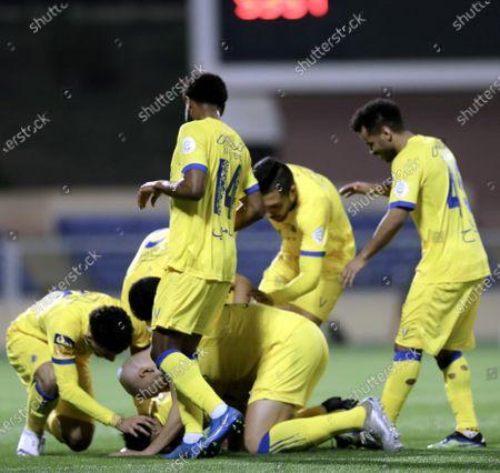 Al-Nassr's players celebrate after teammate Abdulrahman Al-Obaid (down) scores a goal during the Saudi Professional League soccer match between Damac and Al-Nassr at Prince Sultan bin Abdul Aziz Stadium, in Abha, Saudi Arabia, 09 April 2021.