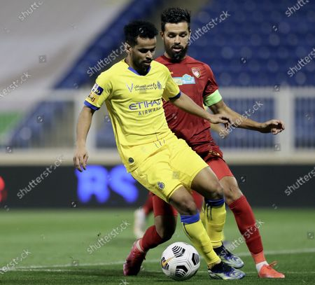 Damac's player Farouk Chafai (back) in action against Al-Nassr's Abdulfattah Asiri (front) during the Saudi Professional League soccer match between Damac and Al-Nassr at Prince Sultan bin Abdul Aziz Stadium, in Abha, Saudi Arabia, 09 April 2021.