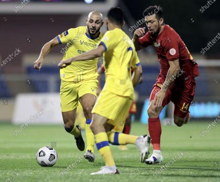 Damac's player Sergio Vittor (R) in action against Al-Nassr's Nordin Amrabat (L) during the Saudi Professional League soccer match between Damac and Al-Nassr at Prince Sultan bin Abdul Aziz Stadium, in Abha, Saudi Arabia, 09 April 2021.