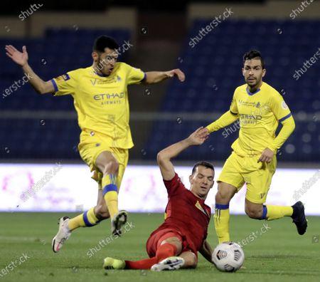 Damac's player Emilio Zelaya (C) in action against Al-Nassr's Sultan Al-Ghannam (L) and Petros (R) during the Saudi Professional League soccer match between Damac and Al-Nassr at Prince Sultan bin Abdul Aziz Stadium, in Abha, Saudi Arabia, 09 April 2021.