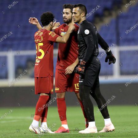 Damac's players celebrate after winning the Saudi Professional League soccer match between Damac and Al-Nassr at Prince Sultan bin Abdul Aziz Stadium, in Abha, Saudi Arabia, 09 April 2021.