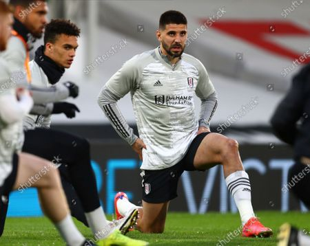 Fulham's Aleksandar Mitrovic, right, warms up before the English Premier League soccer match between Fulham and Wolverhampton Wanderers at Craven Cottage stadium in London, England