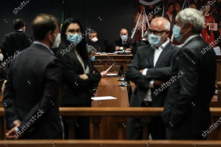 The prosecutor Rosario Teixeira (C-L), and judge Vitor Pinto (C-R) in the beginning of the instructional decision session of the high-profile corruption case known as Operation Marques, which involves the Portugal's former Prime Minister Jose Socrates,  at the Justice Campus in Lisbon, Portugal, 09 April 2021. Operation Marques has 28 defendants - 19 people and 9 companies - including former Prime Minister Jose Socrates, banker Ricardo Salgado, businessman and friend of Socrates Carlos Santos Silva, and senior executives of Portugal Telecom, and is related to crimes of active and passive corruption, money laundering, document forgery, and tax fraud.