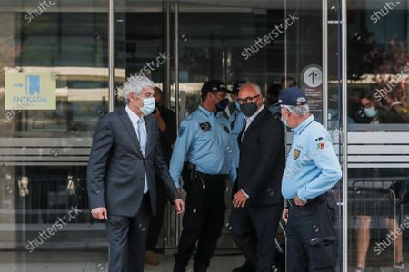 The defendant and former Prime Minister Jose Socrates (L) and his lawyer Pedro Delille (2R) leave the court after the reading of the instructional decision of the high-profile corruption case known as Operation Marques, at the Justice Campus in Lisbon, Portugal, 09 April 2021. Operation Marques has 28 defendants - 19 people and 9 companies - including former Prime Minister Jose Socrates, banker Ricardo Salgado, businessman and friend of Socrates Carlos Santos Silva, and senior executives of Portugal Telecom, and is related to crimes of active and passive corruption, money laundering, document forgery, and tax fraud.