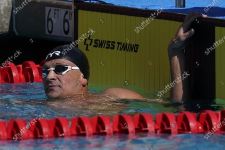 Ryan Lochte looks at the results in the men's 200-meter final at the TYR Pro Swim Series swim meet, in Mission Viejo, Calif