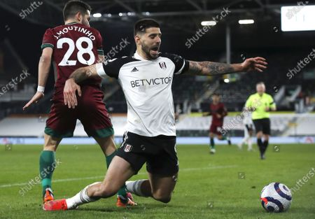 Aleksandar Mitrovic (R) of Fulham in action against Joao Moutinho (L) of Wolverhampton during the English Premier League match between Fulham and Wolverhampton Wanderers in London, Britain, 09 April 2021.