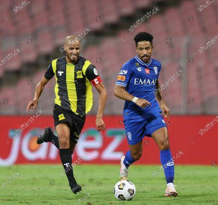 Stock Image of Al-Ittihad's player Karim El Ahmadi (L) in action against Al-Hilal's Hattan Bahebri (R) during the Saudi Professional League soccer match between Al-Ittihad and Al-Hilal at King Abdulaziz Stadium, in Mecca, Saudi Arabia, 09 April 2021.